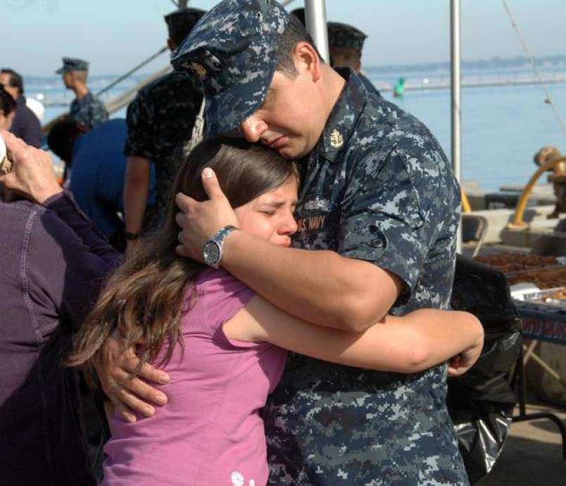 Navy father saying goodbye to daughter