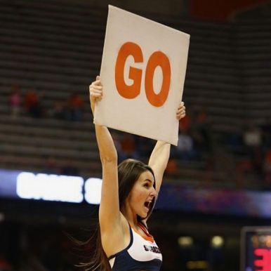 "Cheerleader holding ""Go"" sign"